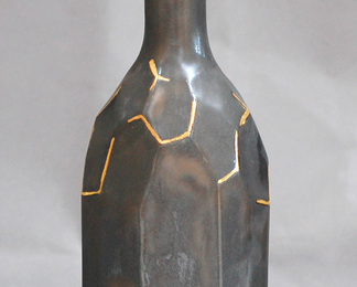 Black Faceted Bottle with Gold Details
